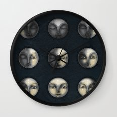 moon phases and textured darkness Wall Clock