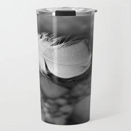 White Feather Floating on Water Travel Mug