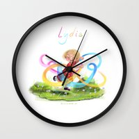 lydia martin Wall Clocks featuring Lydia by Louis Van Driessche