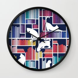 Rainbow bookshelf // navy blue background white shelf and library cats Wall Clock