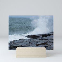 Waves breaking on a rocky shore Mini Art Print