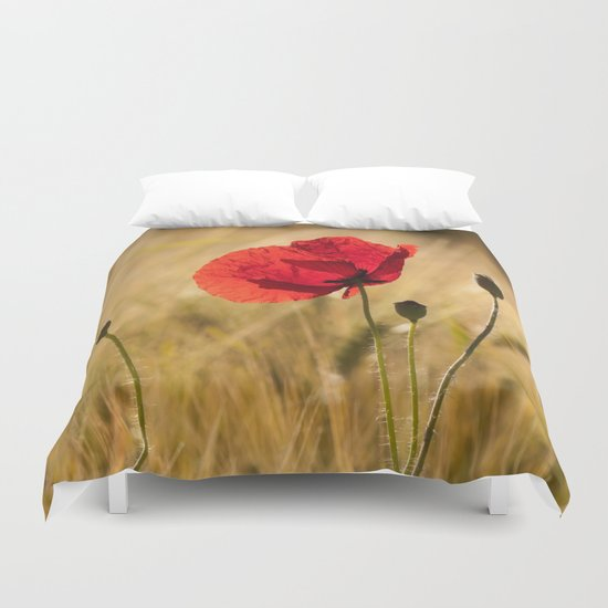 Poppies in a summerfield Duvet Cover