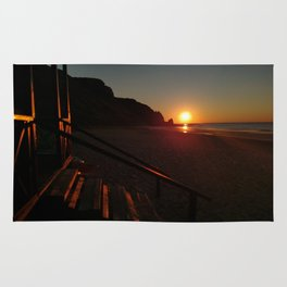 Shack by the sea at sunrise Rug