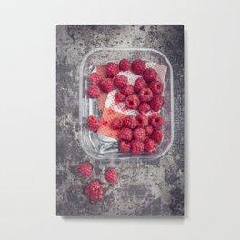 Raspberries in plastic container on old metal baking tray Metal Print
