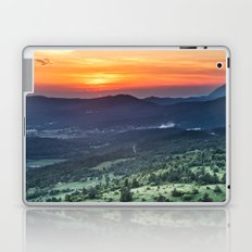 Beautiful sunset behind green fields Laptop & iPad Skin