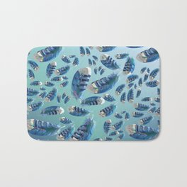 """Blue feathers flying in the air"" Bath Mat"
