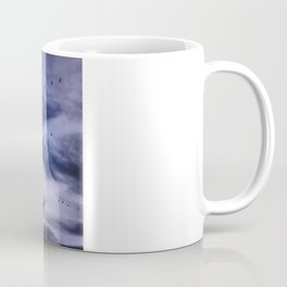 On a left along the moon and further to the east. Coffee Mug