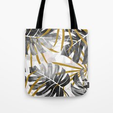Monstera black and white with golden leaves Tote Bag