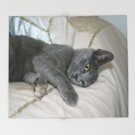 Grey Kitten Relaxed On A Bed  Throw Blanket