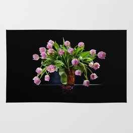 Pink tulips bouquet in glass vase Rug