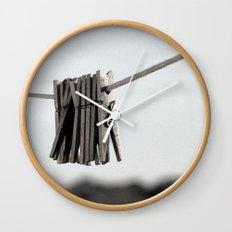 In a pinch Wall Clock
