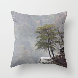 Tree on a rocky ledge in the fog Throw Pillow