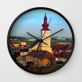 Village and church in warm sundown light | landscape photography Wall Clock