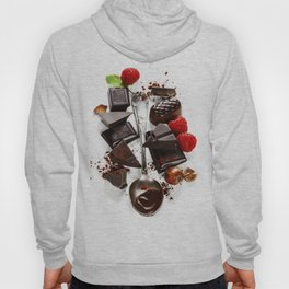 An assortment of  chocolate on white background Hoody