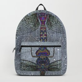 Dragonfly on blue stone and metal background Backpack