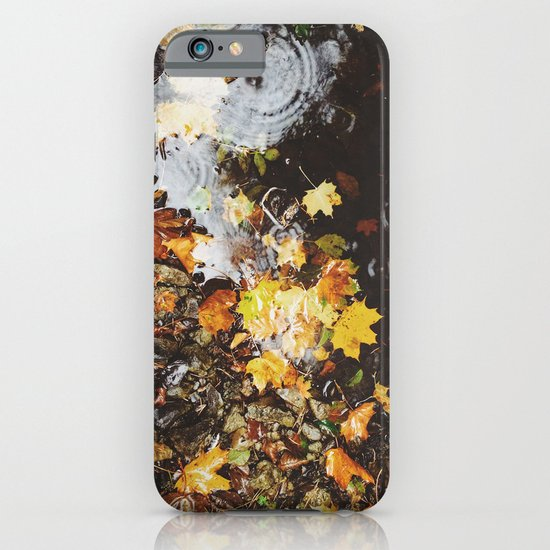 Detail of autumnal leaves and rain in a puddle. Norfolk, UK iPhone & iPod Case