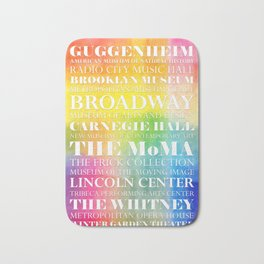 New York Arts - white text on color Bath Mat