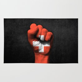 Swiss Flag on a Raised Clenched Fist Rug