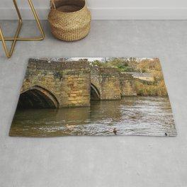 Ancient stone bridge crossing the River Wye in the town of Bakewell Rug