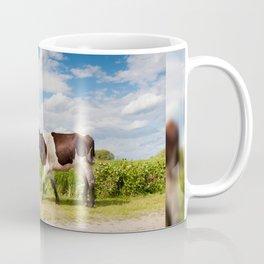 Calf walking in natural landscape Coffee Mug
