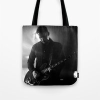 arctic monkeys Tote Bags featuring jamie cook // arctic monkeys by Hattie Trott