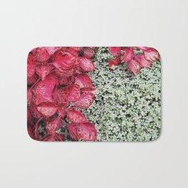 Pink Leaves on Green Carpet Bath Mat