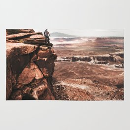 man on top of canyonlands Rug