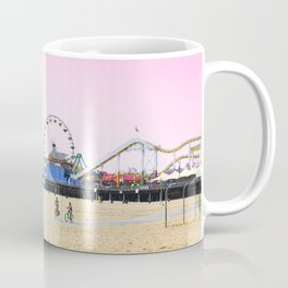 Santa Monica Pier with Ferries Wheel and Roller Coaster Against a Pink Sky Coffee Mug