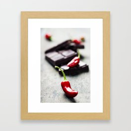 Dark chocolate with chili pepper over wooden background Framed Art Print