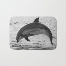 Jumping wild bottlenose dolphin black and white Bath Mat