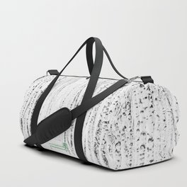 Green bench in white winter forest Duffle Bag