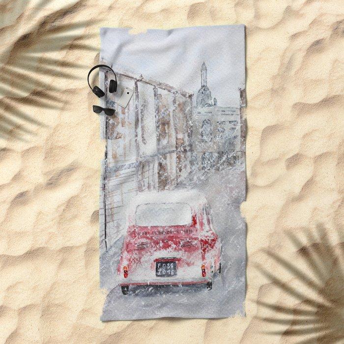 Snowfall and little red car Beach Towel