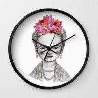 frida kahlo Wall Clocks featuring Frida Kahlo by Maripili