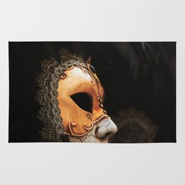 Approach of a Venetian carnival mask with its typical decorations. Rug