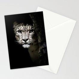 Snow leopard, Panthera uncia, watches from rocky outcrop Stationery Cards