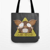 gizmo Tote Bags featuring gizmo by Eva Puyal