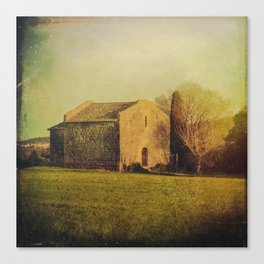 A cute small stone house without windows Canvas Print