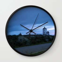 Lighthouse at sunset with silk clouds Wall Clock