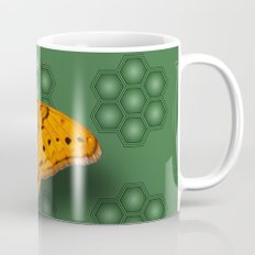 Beautiful orange butterfly on green pattern background Mug