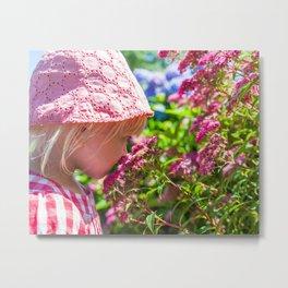 Smelling flowers Metal Print