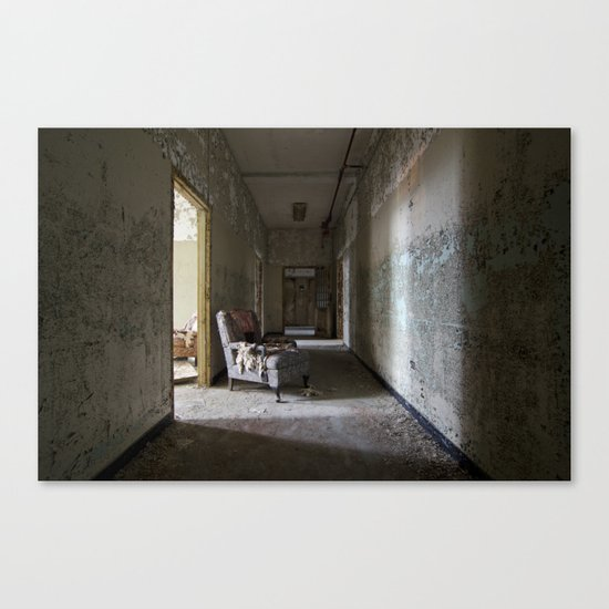 Chair in asylum hallway Canvas Print