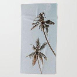 two palm trees Beach Towel