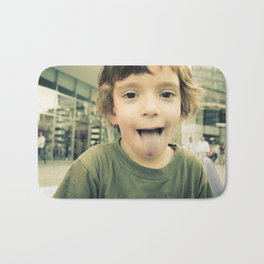 Child with green sweater in the center of Milan in the autumn Bath Mat