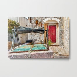 Abandoned traditional well in the medieval mastic village of Vessa on the island of Chios, Greece Metal Print