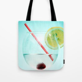 Cocktail with lemon slice, cherry and a straw Tote Bag
