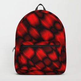 Drops in a red diagonal along the surface of the water on a metal film.  Backpack