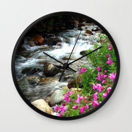 Flowers and flowing Canadian stream Wall Clock
