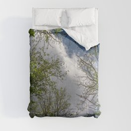 Clouds and trees tops Comforters