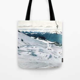 Snowy life on slope under T-bar lifts Tote Bag