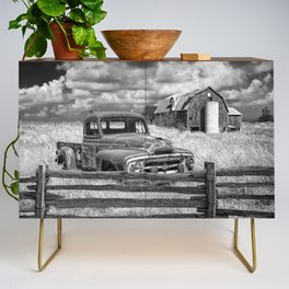 Black and White of Rusted International Harvester Pickup Truck behind wooden fence with Red Barn in Credenza